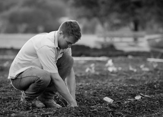 Farmer on land black and white