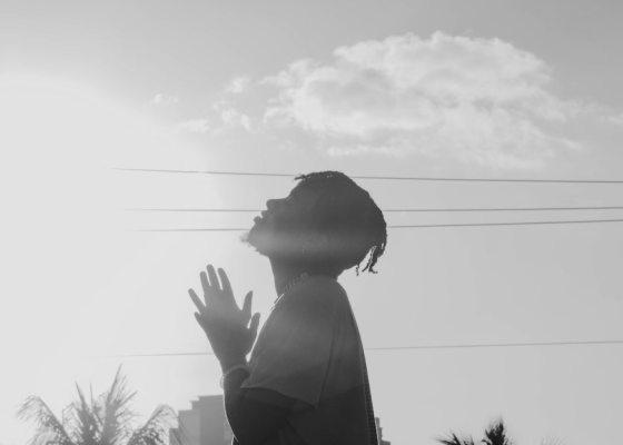 Man praying upwards black and white