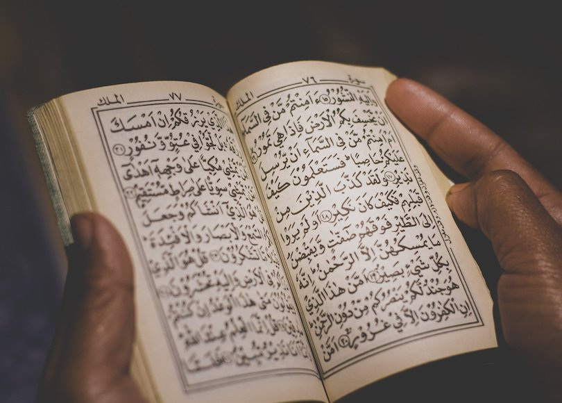 Man holding Quran