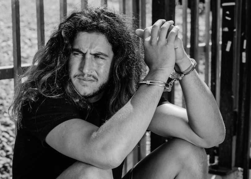 Handcuffed man black and white