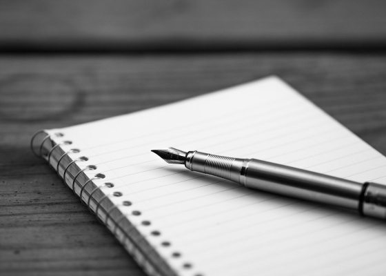 Pen and notebook black and white